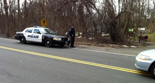 Vernon police stand guard after human remains were found in March.