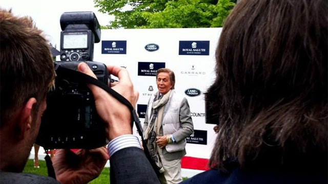 Italian fashion designer Valentino arrives at Prince Harry's charity polo match.