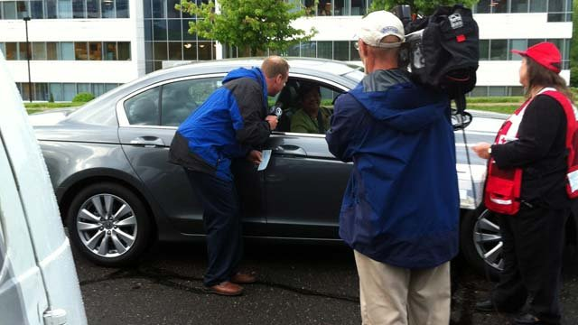 WFSB Meteorologist Scot Haney talks with viewers while collecting donations.