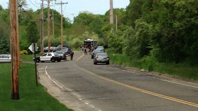 State police searched Quarry Road in Trumbull Friday morning.