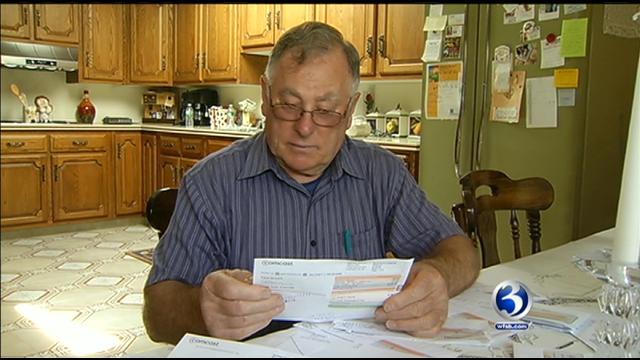 Frank Iacovella of Farmington looks over his Comcast bill.