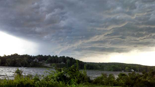 A photo of the clouds over the Connecticut River by the Chester-Hadlyme Ferry.