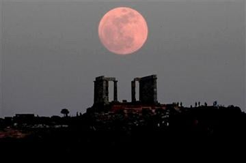 "(AP Photo/Dimitri Messinis). FILE - In this Saturday, May 5, 2012 file photo, a ""supermoon"" rises behind the Temple of Poseidon in Cape Sounion, Greece, southeast of Athens."