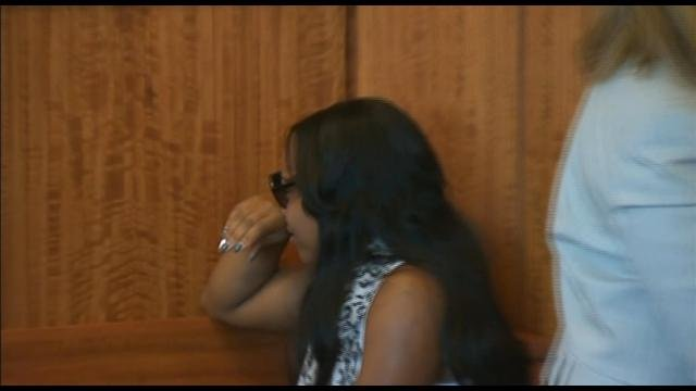 Hernandez's fiancee sobs in the courtroom.
