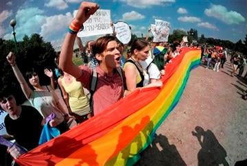(AP Photo/Dmitry Lovetsky). Gay rights activists shout slogans during their authorized rally in St.Petersburg, Russia, Saturday, June 29, 2013.