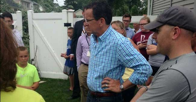 Gov. Dannel P. Malloy talks with residents in Windsor Locks, who suffered damage to their property. (Photo Courtesy: Governor's Office)