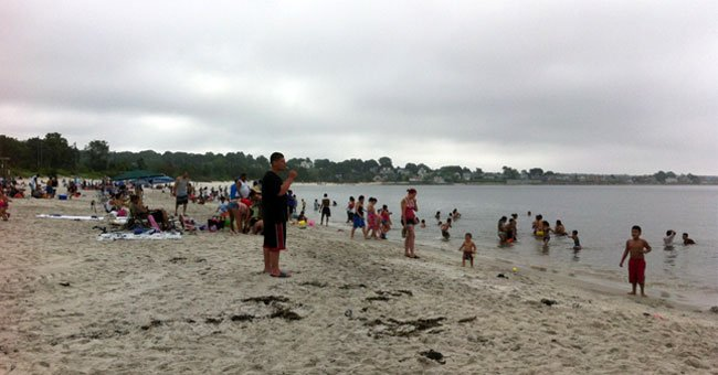 People pack Rocky Neck State Park beach.