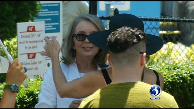 Diane Keaton talks to someone during a movie filming at Lake Compounce in Bristol.