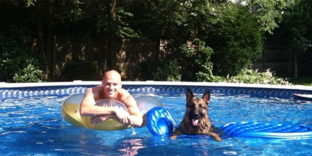 One man and his dog, Ivan, cool off in the pool.