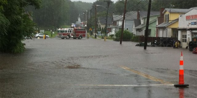 Emergency crews assisting residents in Norwich.