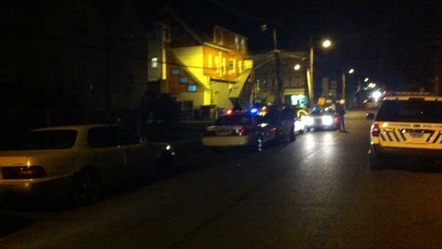Hartford police surround the area of 51 Bond St. Thursday night.