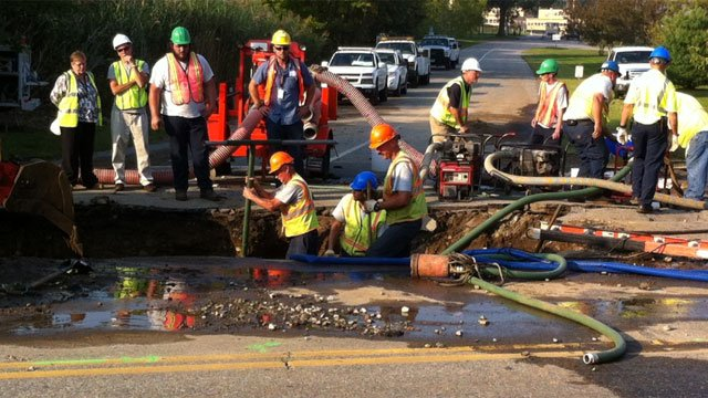 Crews digging up the problem area after a water main break Wednesday.