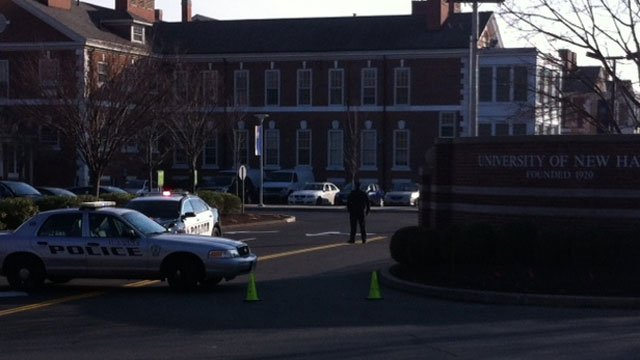 Officers block off the entrance to the UNH campus.