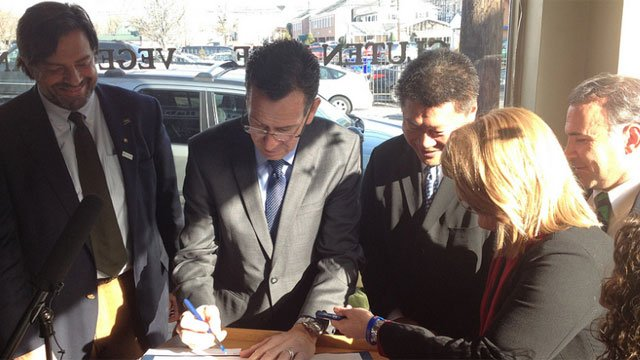 Gov. Dannel P. Malloy signs GMo bill in Fairfield on Wednesday. (Picture courtesy from governor's Twitter account)