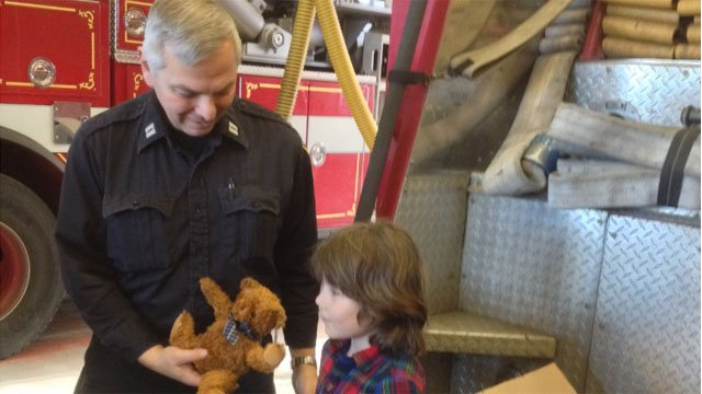 Vladimir Romano donates 25 teddy bears to the Bridgeport Fire Headquarters Tuesday morning.