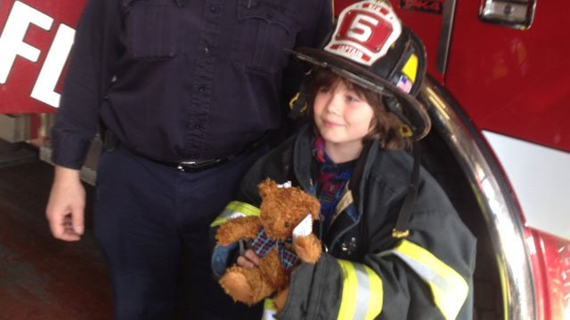 Vladimir Romano shows off one of his teddy bears before he donates them to the Bridgeport Fire Headquarters Tuesday morning.