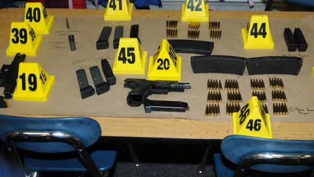 Some of the weapons and ammunition seized by police.