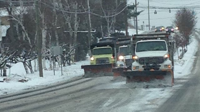 South Windsor Department of Public Works crews clear snow off Buckland Road.