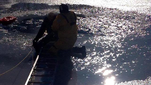 John Sperry being rescued from the ice in West Haven.
