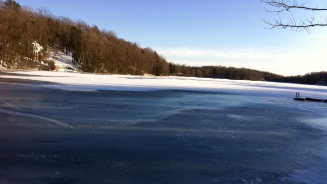 A man and his dog fell through the ice on this lake in Ashford.