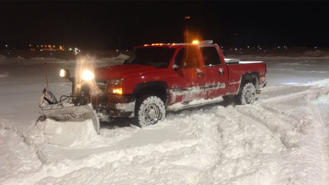 Justin Plowing at Bradley Airport where the snow is heavy.