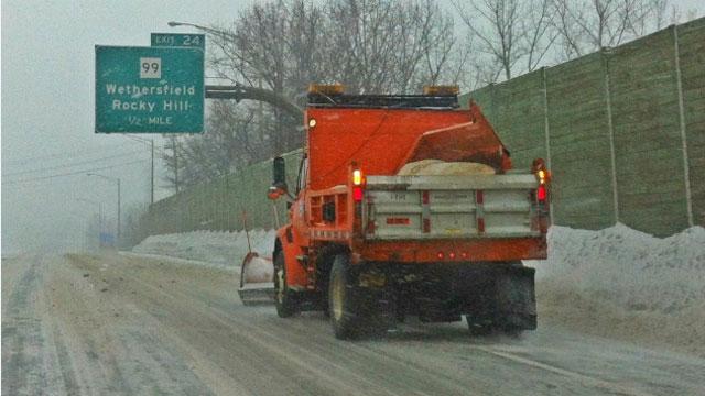 A plow truck clears Interstate 91 in Wethersfield.