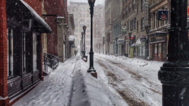 Snow covers Pratt Street in Hartford.