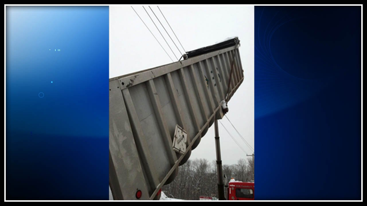 Two workers were shocked when a dump truck struck electrical wires, polices said. (South Windsor police photo)