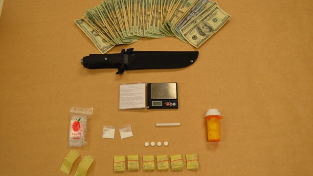 Police said they discovered a number of drugs, a knife and cash in Dubaj's vehicle. (Newington police photo)