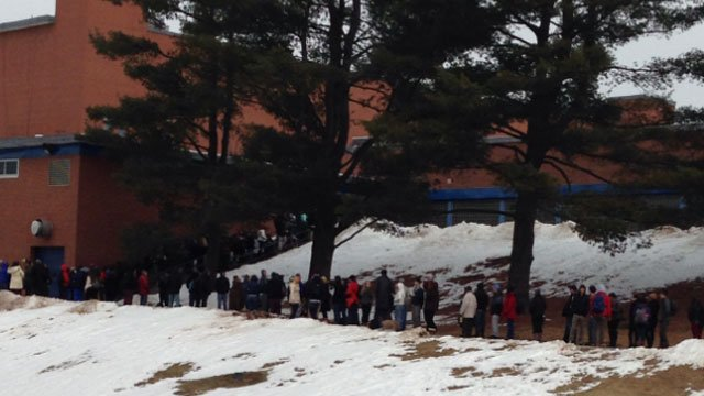 People wait in line to see the president speak at CCSU on Wednesday.
