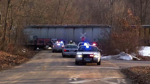 One injury was reported after a car hit a train in Mansfield, troopers said. (WFSB photo)
