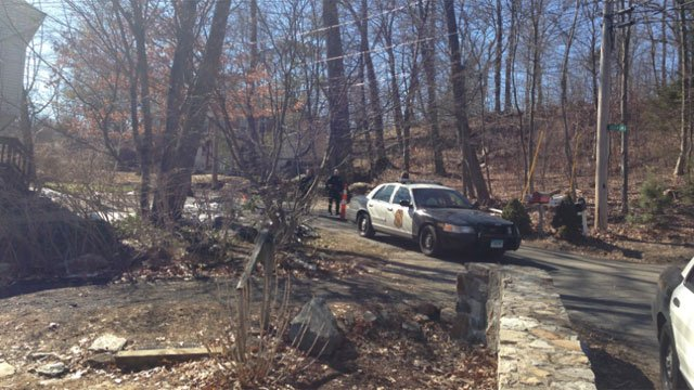 Police focused on a wooded area off Agawam Trail in Shelton. (WFSB photo)