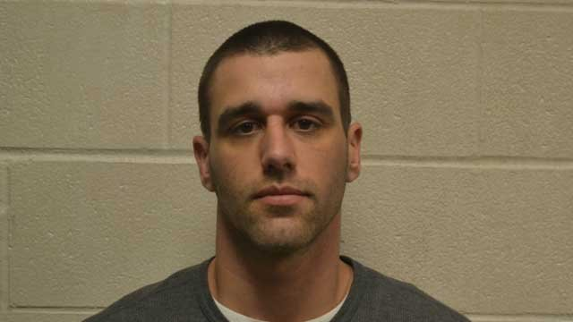 Brett Downs was arrested for armed robbery by police in a third town. (Newington police photo)