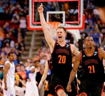 (AP Photo/Gerry Broome). Mercer forward Jakob Gollon (20) and guard Langston Hall (21) celebrate after defeating Duke 78-71 in an NCAA college basketball second-round game against Duke, Friday, March 21, 2014, in Raleigh, N.C.