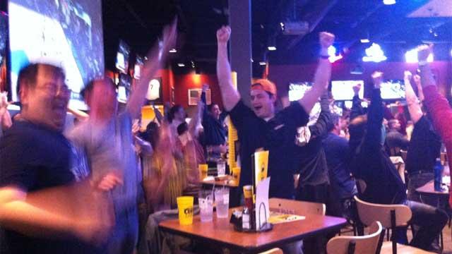 Fans celebrate the UConn win at Buffalo Wild Wings in Wethersfield.