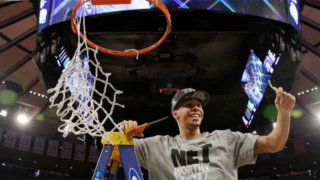 Connecticut's Shabazz Napier smiles after cutting the net after a regional final against Michigan State in the NCAA college basketball tournament Sunday. (AP Photo/Seth Wenig)