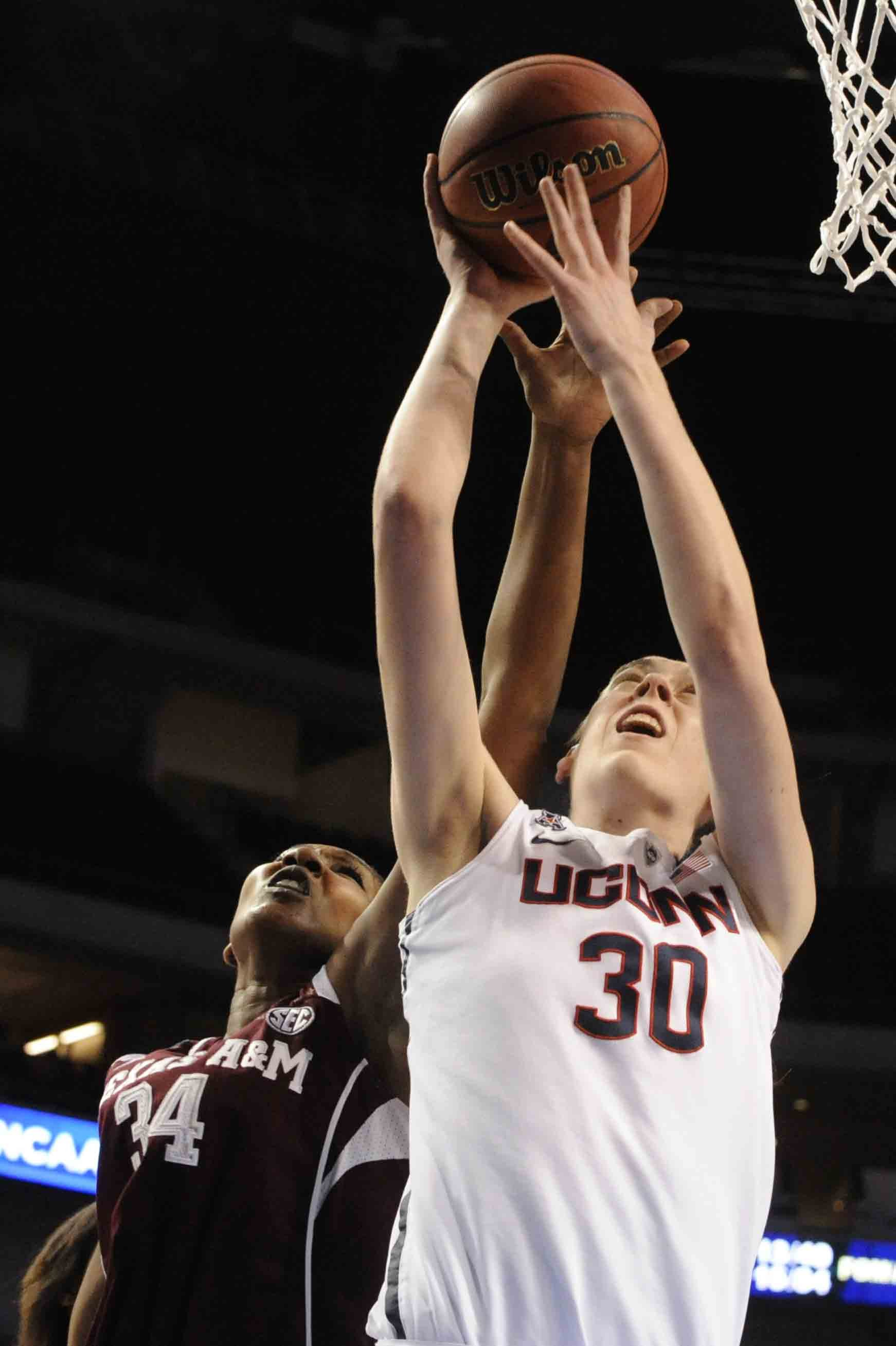 Connecticut's Breanna Stewart (30) takes a shot in front of Texas A&M's Karla Gilbert (34) during the second half of their Monday March 31, 2014 regional final in the NCAA college basketball tournament in Lincoln, Neb. (AP Photo/Dave Weaver)