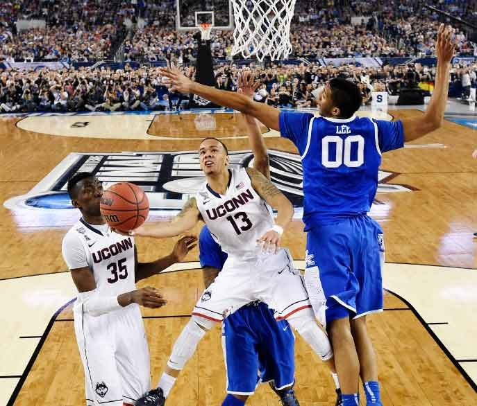 UConn guard Shabazz Napier (13) shoots as Kentucky forward Marcus Lee (00) defends as center Amida Brimah (35) looks on. (AP Photo)