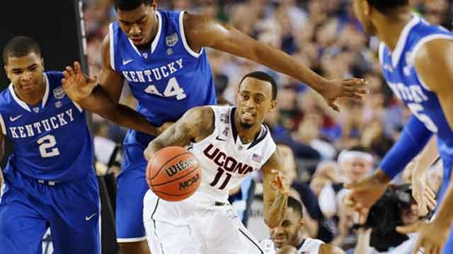 Connecticut guard Ryan Boatright (11) gets past Kentucky guard Aaron Harrison (2), as guard Andrew Harrison (5) looks on during the first half. (AP Photo)