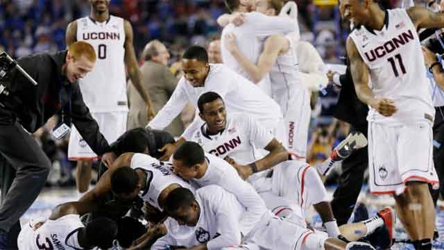 The UConn Huskies celebrate after winning the NCAA Final Four tournament college basketball championship game against Kentucky Monday