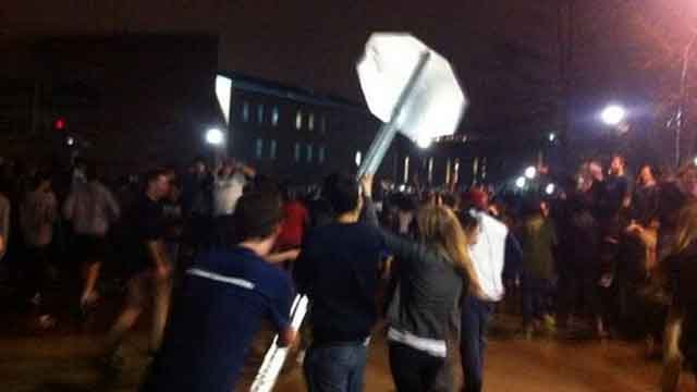 People were spotted knocking over a stop sign near Gampel Pavilion.