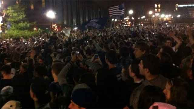 Thousands of UConn students rush out of Gampel.