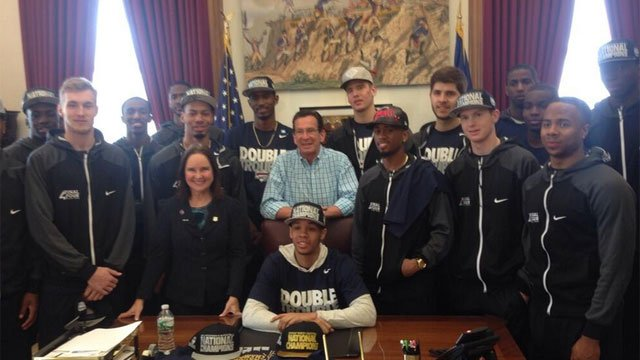 UConn men's basketball team poses for a photo with Gov. Dannel P. Malloy and Connecticut Secretary of State Denise Merrill  (Photo Courtesy: governor's Twitter account)
