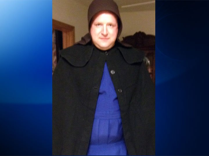 In this undated photo provided by Sgt. Chad Adams of the Pulaski Township Police, Adams is seen dressed as an Amish woman. (AP Photo/Courtesy of Chad Adams)