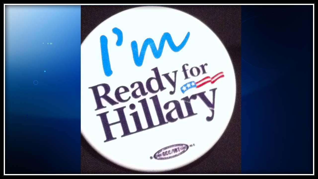 These buttons were handed out before Clinton's speaking engagement. (WFSB photo)