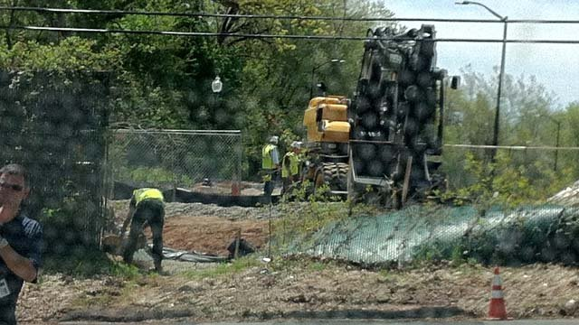 Crews work to remove the fence. (WFSB photo)