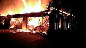 (AP Photo/Hillsborough County Sheriff's Office). In this photo provided by the Hillsborough County Sheriff's Office, flames destroy a home in a gated community Wednesday May 7, 2014 in Tampa, Fla.