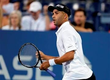 (AP Photo/Darron Cummings). FILE - In this Aug. 28, 2013 file photo, James Blake reacts during a first round match against Ivo Karlovic, of Croatia, at the U.S