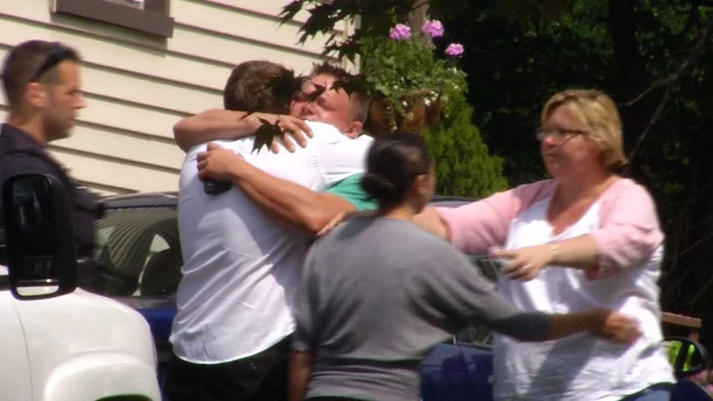 Friends and family shared tears and hugs following Wednesday's murder-suicide in Bristol. (WFSB photo)