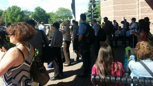 Commuters waiting for buses after being taken off train near Norwalk. (Beth Scorzato/Twitter photo)